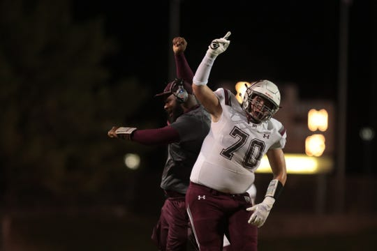 Rancho Mirage's Alex Roma (70) and a coach celebrate a touchdown in La Quinta, Calif., on Friday, October 4, 2019.