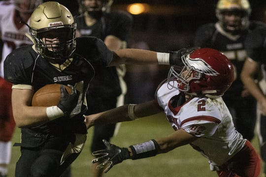 Delone Catholic's Tate Neiderer, left, stiff-arms Bermudian Springs' Ethan Beachy, right. Delone Catholic defeats Bermudian Springs 42-15 in football at Delone Catholic High School in McSherrystown, Friday, October 4, 2019.
