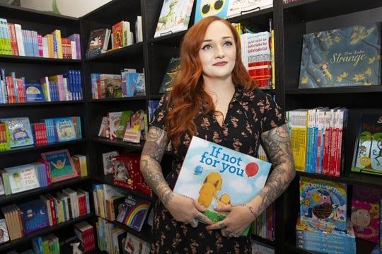 Andrea Montepagano, owner of Enchanted Chapters bookstore, stands in her store on Oct. 3, 2019, in Phoenix, Ariz. The bookstore is meant to be inclusive, particularly for children with autism.