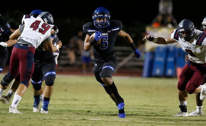 Chandler's Eli Sanders (6) finds a hole against the Perry defense and runs for a touchdown during their game in Chandler, Friday, Oct. 04, 2019.