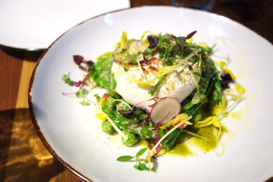 Burrata with winter peas, pomegranate, radish and salsa verde at Mora Italian in Phoenix.