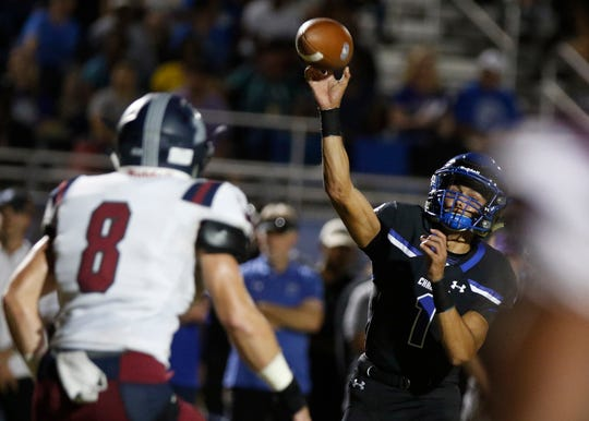Chandler quarterback Mikey Keene throws a pass against Perry's defense during their game in Chandler, Friday, Oct. 04, 2019.