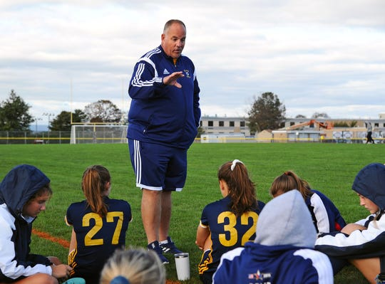 lco head coach Derek Fulk talks to his team at halftime of a game between the Elco Raiders and Solanco Golden Mules Oct. 4. at Elco High School.