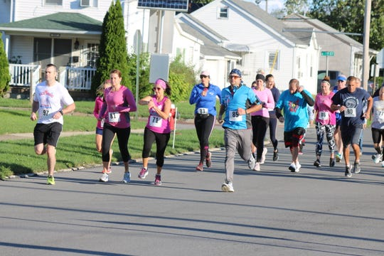 Dozens of runners and walkers, some in fitting pink attire, made their way around Port Clinton on Saturday morning for the annual Bras for a Cause 5K.