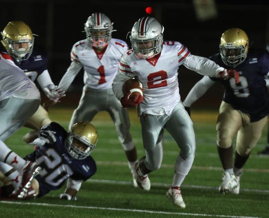 Yonkers Brave's Cordei Atkinson-Gardner runs with the handoff from Ryan Veras (1) during their game at Roosevelt High School Oct. 4, 2019. The Brave beat The Force 14-8.