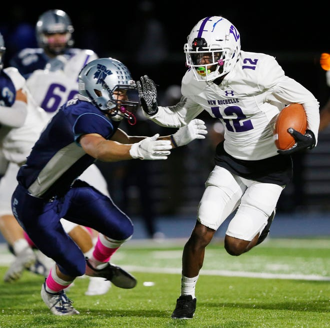 New Rochelle running back Jessie Parson delivers a stiff arm as he turns up field during Friday's game against John Jay-East Fishkill.