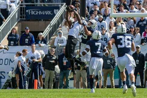 Oct 5, 2019; University Park, PA, USA; Purdue Boilermakers wide receiver David Bell (3) makes a catch over Penn State Nittany Lions cornerback John Reid (29) during the second quarter at Beaver Stadium. Mandatory Credit: John Jones-USA TODAY Sports