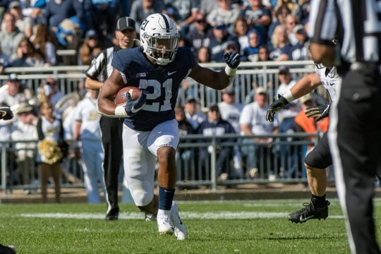 Oct 5, 2019; University Park, PA, USA; Penn State Nittany Lions running back Noah Cain (21) carries the ball against the Purdue Boilermakers during the third quarter at Beaver Stadium. Mandatory Credit: John Jones-USA TODAY Sports