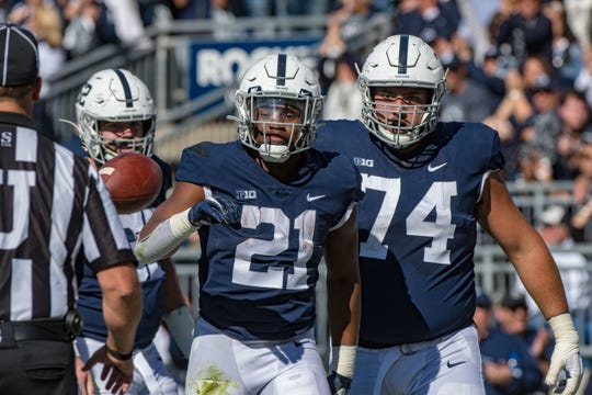 Penn State Nittany Lions running back Noah Cain (21) celebrates with offensive lineman Steven Gonzalez (74) after scoring a touchdown against the Purdue Boilermakers during the third quarter at Beaver Stadium.