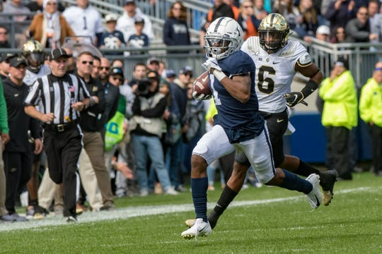Oct 5, 2019; University Park, PA, USA; Penn State Nittany Lions wide receiver KJ Hamler (1) returns a punt against the Purdue Boilermakers during the first quarter at Beaver Stadium. Mandatory Credit: John Jones-USA TODAY Sports