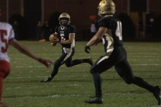 Delone Catholic quarterback Kevin Mowrey, center, looks to throw the ball. Delone Catholic defeated Bermudian Springs, 42-15, at Delone Catholic High School in McSherrystown on Friday.