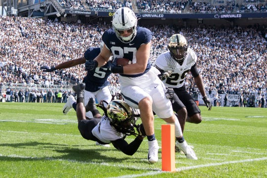 Penn State tight end Pat Freiermuth (87) scores on a 7-yard touchdown pass in the second quarter of an NCAA college football game against Purdue in State College, Pa., on Saturday, Oct. 5, 2019. (AP Photo/Barry Reeger)