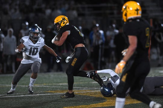 Bishop Manogue's Mateo Raviglio (3) tries to run against Damonte Ranch during their football game in Reno on Oct. 4, 2019.