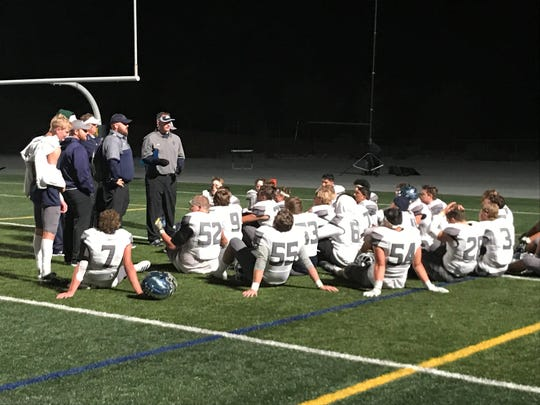Damonte Ranch coach Shawn Dupris talks to his team after beating Bishop Manogue, 27-10, Friday night at Manogue.