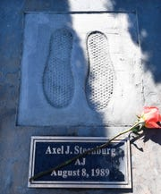 View of rememberance stone in memory of Axel J. Steenburg, at the Reflections Memorial unveiling ceremony, on the one year anniversary of the Schoharie limousine crash that killed 20 people next to the Apple Barrel Restaurant Saturday, Oct. 5, 2019, in Schoharie, N.Y. (AP Photo/Hans Pennink)