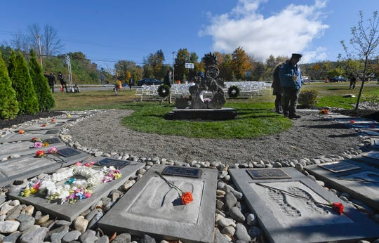 First responders look over the Reflections Memorial after a unveiling ceremony Oct. 5, 2019, on the one-year anniversary of the Schoharie limousine crash that killed 20 people next to the Apple Barrel Restaurant in Schoharie.