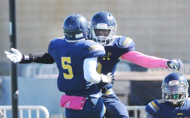UPrep's Andre Facen Jr. celebrates with teammate Mohamed Hussein after Facen returned a blocked punt for a touchdown.