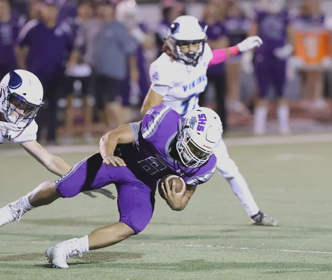Shasta High's Johari Woods carries the ball against Pleasant Valley in the Wolves' 21-20 victory over Pleasant Valley on Friday, Oct. 4, 2019.