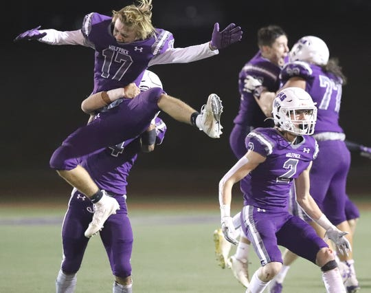 Shasta High's Jack Reindel, left, and Tate Fagan, right, celebrate with teammates after the Wolves pulled out a dramatic 21-20 win over Pleasant Valley on Friday, Oct. 4, 2019.