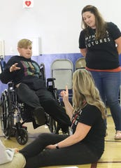 Volunteer mentor Beckie Luff, foreground, talks with student Maddux Morley and mentoring liaison Jenna Berry during a lunchtime session at Turtle Bay Elementary School on Wednesday, Oct. 2, 2019.