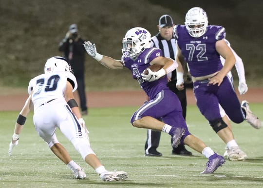 Shasta High's Nathan Bova, center, runs the ball against Pleasant Valley in the Wolves' 21-20 victory Friday, Oct. 4, 2019.