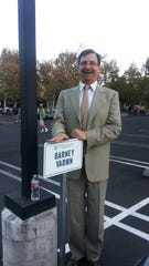 "Actor John Balma stands next to the parking place on ""Parks and Recreation."""