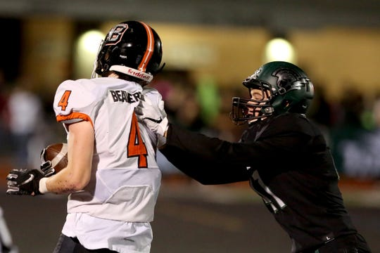 West Salem's Jack Bennett (41) shoves Beaverton's Trent Walker (4) out of bounds in the Beaverton vs. West Salem football game at West Salem High School on Oct. 4, 2019. Beaverton won the game 28-21.