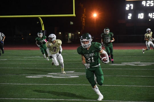 Trojans senior David Maciel's (31) production on offense and defense could help power the Trojans to victory Friday.