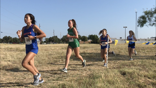 Wall High School's Shaylee Shiller (middle, in green) competes earlier this season at the ASU Stampede, at the ASU Intramural Fields. The junior finished first in the girls division at the Ballinger Invitational, Wednesday, Oct. 2, 2019, in Ballinger.