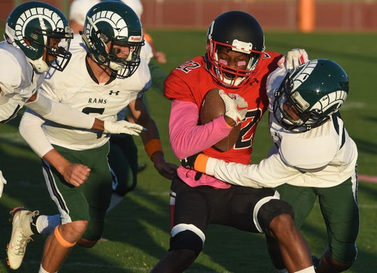 Bennett's Tariq Williams runs the ball during first half action of Friday's nights game of Parkside High School against James M. Bennett High School at County Stadium. The Rams won the game 28-15. (Photo by Todd Dudek for The Daily Times)