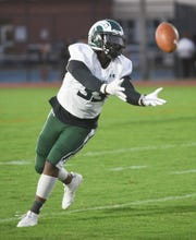 Parkside's Jabronte Mills grabs a kick-off during first half action of Friday's nights game of Parkside High School against James M. Bennett High School at County Stadium. The Rams won the game 28-15. (Photo by Todd Dudek for The Daily Times)