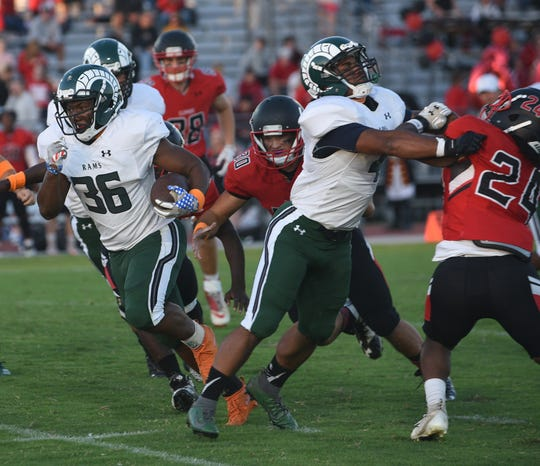 Parkside's Alijah Bivans goes for a long run during first half action of Friday's nights game of Parkside High School against James M. Bennett High School at County Stadium. The Rams won the game 28-15. (Photo by Todd Dudek for The Daily Times)