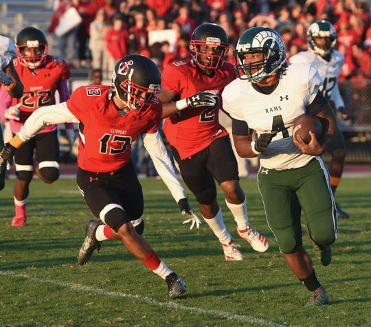 Parkside's Davian White goes for a touchdown during first half action of Friday's nights game of Parkside High School against James M. Bennett High School at County Stadium. The Rams won the game 28-15. (Photo by Todd Dudek for The Daily Times)