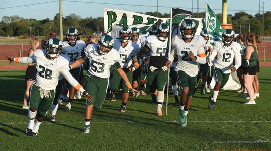 Parkside takes the field of Friday's nights game of Parkside High School against James M. Bennett High School at County Stadium. The Rams won the game 28-15. (Photo by Todd Dudek for The Daily Times)