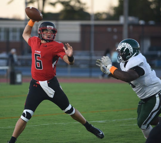 Bennett's Sam Blackmon gets ready to throw the ball during first half action of Friday's nights game of Parkside High School against James M. Bennett High School at County Stadium. The Rams won the game 28-15. (Photo by Todd Dudek for The Daily Times)