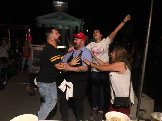 Chef Eleazar Mondragon celebrates with family after winning the 2019 Battle for the Golden Fork competition.