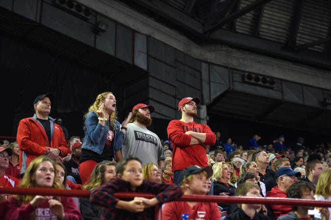 A South Dakota Coyotes fan yells down to the field during their homecoming game on Saturday, Oct. 5, in the DakotaDome.