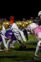 Winner offense prepares to hike the ball during the game against Chamberlain on Friday, Oct. 4, 2019.