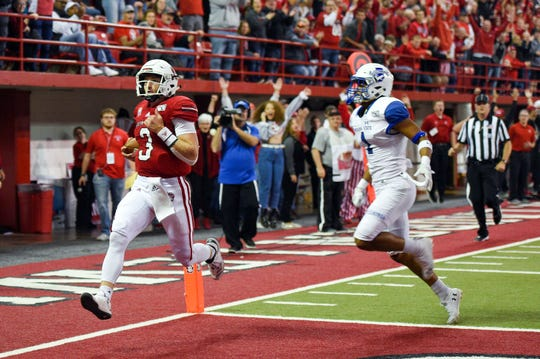 South Dakota Coyotes' Austin Simmons runs the ball in for a touchdown with Indiana State Sycamores' Michael Thomas not far behind during their game on Saturday, Oct. 5, in the DakotaDome.