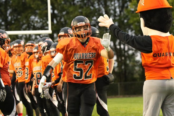 Drew Van Regenmorter of Dell Rapids give the mascot a high five during introductions of Friday's game against Dakota Valley in Dell Rapids.