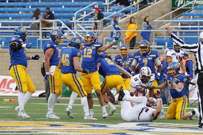 South Dakota State's Logan Backhaus (12) celebrates a defensive stop with his teammates during the fourth quarter of the Jackrabbits' Hobo Day 28-10 victory over the Salukis Saturday afternoon at Dana J. Dykhouse Stadium in Brookings.