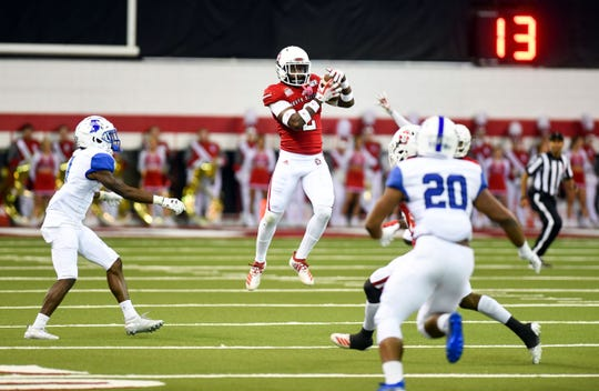 Mike Johnson of the  South Dakota Coyotes intercepts a pass by the Indiana State Sycamores during their homecoming game on Saturday, Oct. 5, in the DakotaDome.