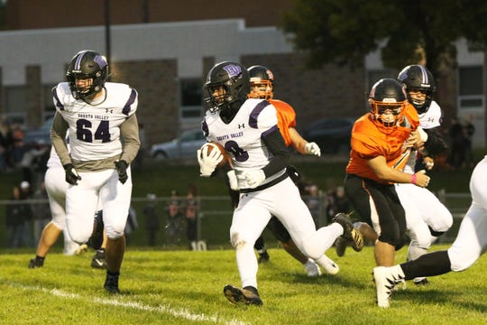 Kobey June of Dakota Valley follows the blocking by Hunter Roper (64) against Dell Rapid during Friday's game in Dell Rapids.