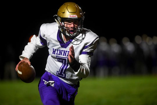 Winner quarterback and defensive back Brady Fritz (7) runs the ball during the first half of the game against Chamberlain on Friday, Oct. 4, 2019.