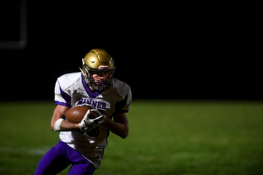 Winner running back and defensive back Trevor Peters (21)  runs the ball during the first half of the game against Chamberlain on Friday, Oct. 4, 2019.