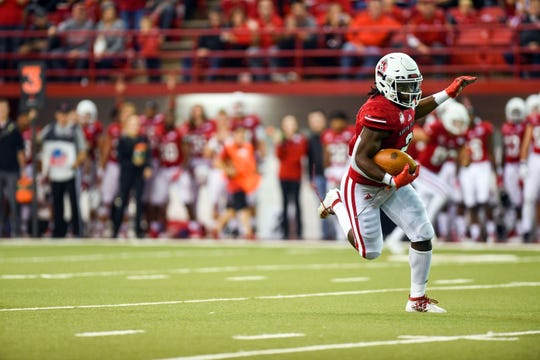 The shoelace of Kai Henry, running back for the South Dakota Coyotes, comes undone as he runs the ball for a touchdown during their homecoming game on Saturday, Oct. 5, in the DakotaDome.