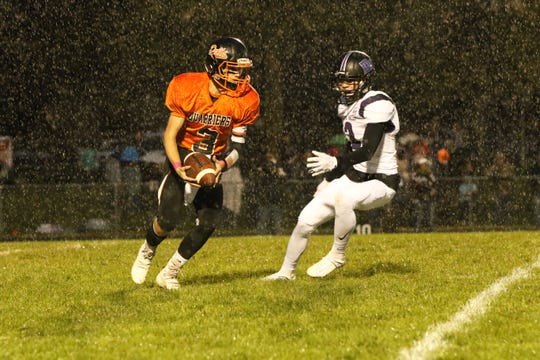 Colin Rentz of Dell Rapids looks to get off a punt as Cole Kennedy of Dakota Valley pursues during Friday's game in Dell Rapids.