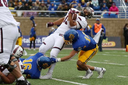 South Dakota State's Logan Backhaus (12) and Levi Brown converge to tackle Southern Illinois' Javon Williams Jr. (15) during the first quarter of the Jackrabbits' Hobo Day matchup against the Salukis Saturday afternoon at Dana J. Dykhouse Stadium in Brookings.