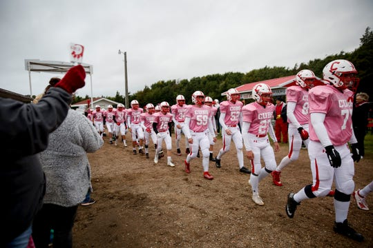 Chamberlain football players are cheered on by their fans before the game against Winner at home on Friday, Oct. 4, 2019.