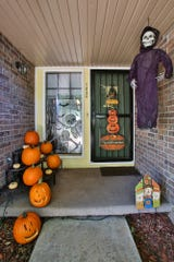 Trick-or-treaters will be greeted with plenty of pumpkins and skeletons when they visit the Freys' house on Halloween.